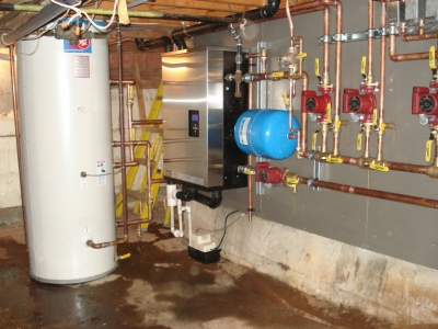 """After""  An indirect fired water heater system installed in Whistler."