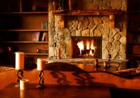 brown wooden table with white pillar candles